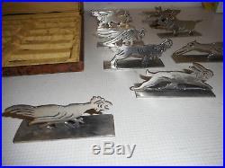 12 PORTE-COUTEAUX ART DECO. Métal argenté. Benjamin Rabier. Orfèvre Pierre Devouge