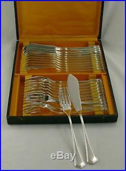 12 couverts à poisson métal argenté modèle Design/Art déco, 24 pièces, écrin