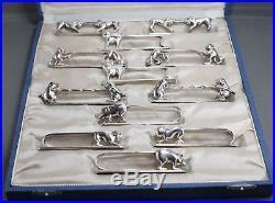 12 porte couteaux Art Déco en métal argenté signés François Frionnet avec écrin