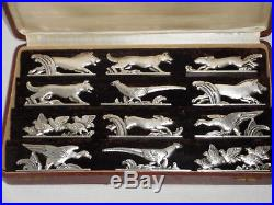 12 porte-couteaux animaliers art déco en métal argenté. Orfèvre Orbrille