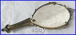 Ancien grand miroir face a main finement travaillé métal argenté art déco