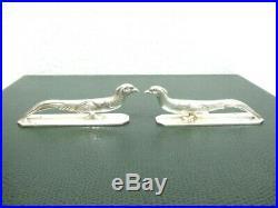Ancienne série de 12 porte couteaux animaliers en métal argenté