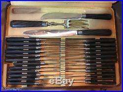 Coffret 24 couteaux Art Déco-manches palissandre-viroles métal argenté+ 3pièces