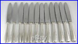 Ercuis modèle Art Déco, 12 couteaux de table, métal argenté