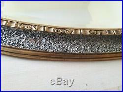 Miroir ovale en métal doré et argenté Période Art-déco 1930