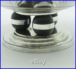 Orbrille. Coupe ronde art déco en métal argenté, début XXe