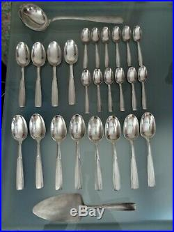 Ravinet d'enfert ménagère couverts en métal argenté motifs art déco 75 pièces