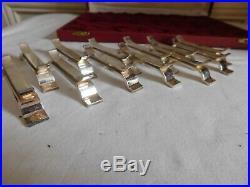 Saint Médard écrin 12 porte-couteaux métal argenté moderniste état brillant