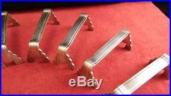 Service de 12 porte couteaux en métal argenté Christofle Art Déco